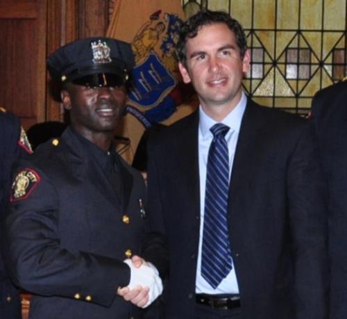 Police Officer Morton Otundo and Jersey City Mayor Steven Fulop